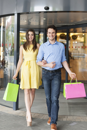 Portrait of fashion couple after a successful shopping